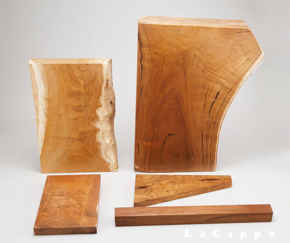 御蔵桑(左側の二丁:本土山桑との交雑種(ハイブリッド)、右側:三角材は玉杢、タクリ杢の最高品)